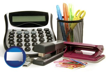 office supplies: calculator, paper clips, pens, scissors, stapler, and staples - with South Dakota icon