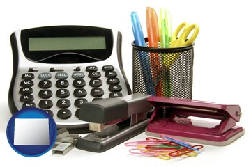 office supplies: calculator, paper clips, pens, scissors, stapler, and staples - with Wyoming icon