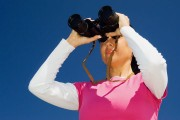 a woman looking through binoculars