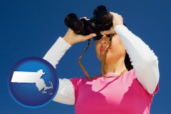 massachusetts map icon and a woman looking through binoculars