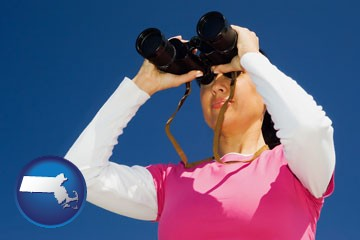 a woman looking through binoculars - with Massachusetts icon
