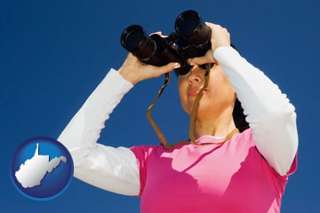a woman looking through binoculars - with West Virginia icon