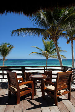 outdoor furniture on a tropical, oceanfront deck