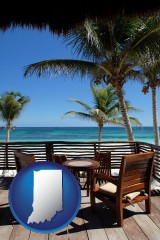 indiana outdoor furniture on a tropical, oceanfront deck