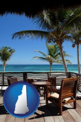 new-hampshire map icon and outdoor furniture on a tropical, oceanfront deck