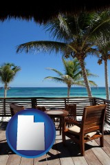 utah map icon and outdoor furniture on a tropical, oceanfront deck