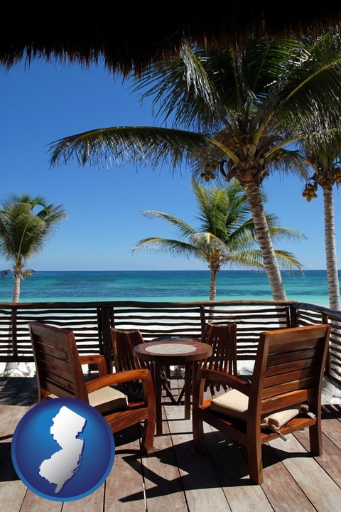 outdoor furniture on a tropical, oceanfront deck - with New Jersey icon - Outdoor Furniture Retailers In New Jersey