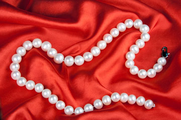 a faux pearl necklace