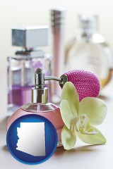 arizona a perfume bottle, with atomizer, and an orchid flower