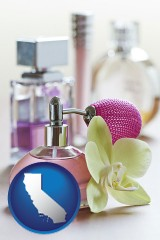 california a perfume bottle, with atomizer, and an orchid flower