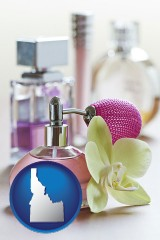 idaho a perfume bottle, with atomizer, and an orchid flower