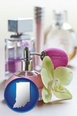 indiana a perfume bottle, with atomizer, and an orchid flower