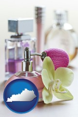 kentucky a perfume bottle, with atomizer, and an orchid flower