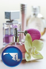 maryland a perfume bottle, with atomizer, and an orchid flower