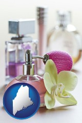 maine a perfume bottle, with atomizer, and an orchid flower