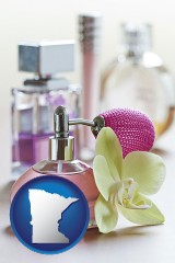 minnesota a perfume bottle, with atomizer, and an orchid flower
