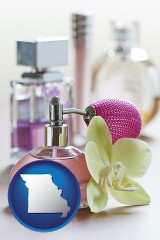 missouri a perfume bottle, with atomizer, and an orchid flower