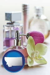 montana a perfume bottle, with atomizer, and an orchid flower