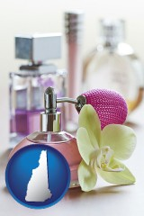 new-hampshire a perfume bottle, with atomizer, and an orchid flower