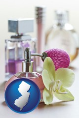 new-jersey a perfume bottle, with atomizer, and an orchid flower
