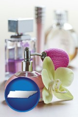 tennessee a perfume bottle, with atomizer, and an orchid flower