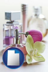 utah a perfume bottle, with atomizer, and an orchid flower