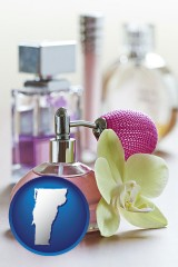 vermont a perfume bottle, with atomizer, and an orchid flower