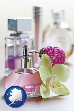 a perfume bottle, with atomizer, and an orchid flower - with Alaska icon