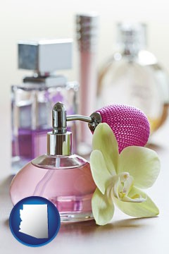 a perfume bottle, with atomizer, and an orchid flower - with Arizona icon