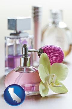 a perfume bottle, with atomizer, and an orchid flower - with California icon