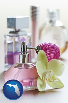 a perfume bottle, with atomizer, and an orchid flower - with Florida icon