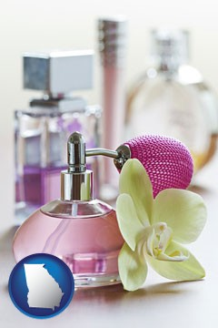 a perfume bottle, with atomizer, and an orchid flower - with Georgia icon