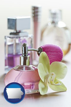 a perfume bottle, with atomizer, and an orchid flower - with Iowa icon