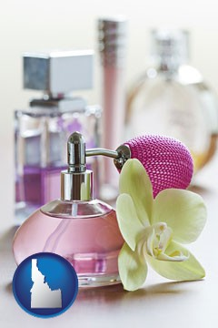 a perfume bottle, with atomizer, and an orchid flower - with Idaho icon