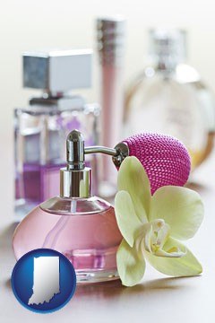 a perfume bottle, with atomizer, and an orchid flower - with Indiana icon