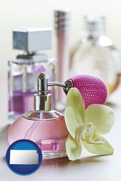 a perfume bottle, with atomizer, and an orchid flower - with Kansas icon