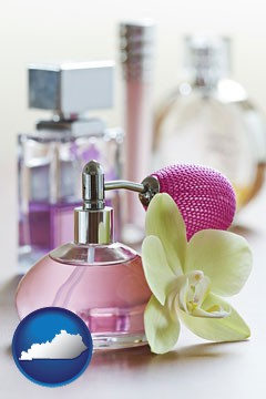a perfume bottle, with atomizer, and an orchid flower - with Kentucky icon