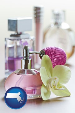 a perfume bottle, with atomizer, and an orchid flower - with Massachusetts icon