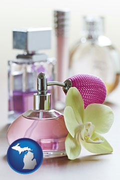 a perfume bottle, with atomizer, and an orchid flower - with Michigan icon