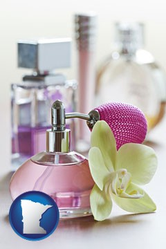 a perfume bottle, with atomizer, and an orchid flower - with Minnesota icon