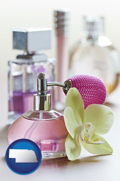 a perfume bottle, with atomizer, and an orchid flower - with Nebraska icon