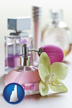 a perfume bottle, with atomizer, and an orchid flower - with New Hampshire icon