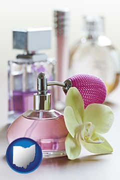 a perfume bottle, with atomizer, and an orchid flower - with Ohio icon