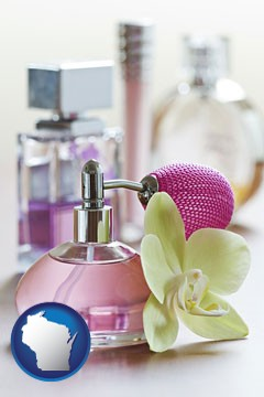 a perfume bottle, with atomizer, and an orchid flower - with Wisconsin icon