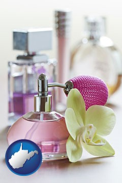 a perfume bottle, with atomizer, and an orchid flower - with West Virginia icon