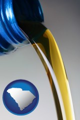 south-carolina map icon and motor oil being poured from a container