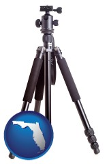 florida map icon and a camera tripod