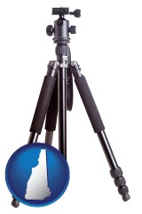 nh map icon and a camera tripod