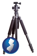new-jersey map icon and a camera tripod