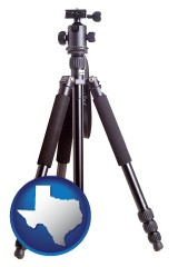 texas map icon and a camera tripod